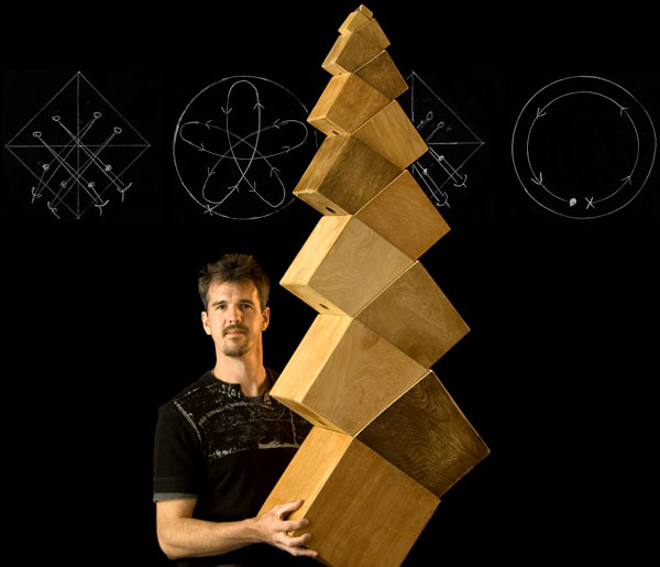 Boxes: Greg Kennedy supporting a structure of stacked boxes